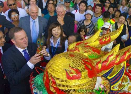 John Key dressing and waking the dragon - photo by John Ling