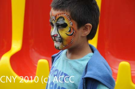 Child with face painting - photo by John Ling